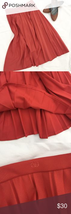 "Vintage Givenchy pleated midi skirt 28"" waist Vintage Givenchy pleated midi skirt 28"" waist. Beautiful pinky coral color somewhere between the first filtered pic and the other unfiltered pics. Lightly used. Excellent vintage condition. Labeled size 8. Can't model but happy to provide measurements. Givenchy Skirts Midi"