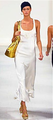 Ralph Lauren simple white dress with big gold handbag and sandals