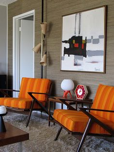 The chairs, the rug, the art, the wallpaper, the hideous pole lamp! Mid-century flashback!