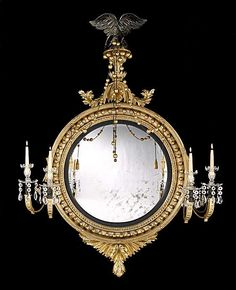 A REGENCY GILTWOOD CONVEX MIRROR ATTRIBUTED TO THOMAS FENTHAM  Circa: 1815