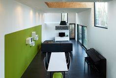 Image 16 of 31 from gallery of Low Energy Bamboo House / AST 77 Architecten. Photograph by Steven Massart Bamboo House, Winter House, Corner Desk, Building A House, Minimalism, Gallery, Interior, Inspiration, Furniture