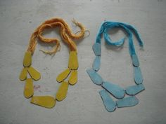 I love the simplicity and colours of these artworks-as-jewellery