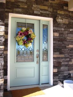 LOVE the stone, the cute little light  the painted front door!  <3