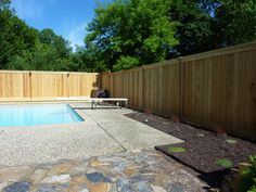 Pool Privacy Fence 6' high cedar wood privacy fence with ornamental aluminum fence