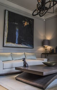 Simple colour scheme is given impact with dramatic painting and contemporary metal chandelier, by De Salles Flint interior design