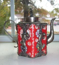 Antique Chinese teapot, red and white ceramic with intricate metal decorations monkey top, butterflies and dragons.