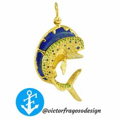 Chic Mahi Mahi pendant. A masterpiece so life like it would move if it could! 14kt gold and genius stones !