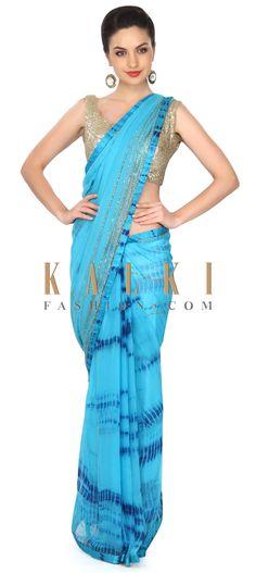 Buy this Peacock blue saree adorn in batik print and kardana work only on Kalki
