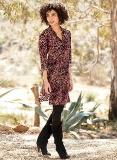 Painterly vines in rich gold accented with berry tones dapple the black ground…