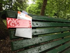 A simple red clip for sharing papers on public benches. By Pivot Creative, Amsterdam.