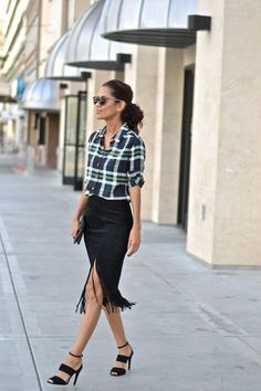 Putting together a casual date night outfit isn't always as easy as slipping on a LBD. Marisela of Diverse City Style strikes a balance between stylish and comfortable with a slouchy button-up shirt and a flirty fringed skirt—an easy formula to re-create no matter what your personal style may be.