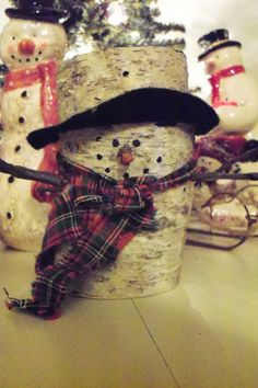 so cool....a little snow guy made from a birch log!