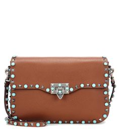 f62d360396 Valentino - Rockstud Rolling leather shoulder bag - Keep yourself chic with  Valentino Garavani's Rockstud Rolling