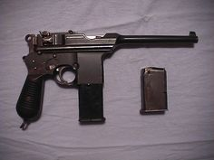 The Mauser C96 Broomhandle still in service  during World War II ,Mauser manufactured approximately 1,200.000 C96 pistols large numbers were also produced by China and Spain