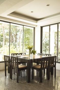 The formal dining room and many other areas of the home have great views of the tree-filled garden.