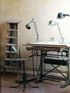 Architect Paul Mrozinski uses a vintage printing table and swing-arm lights to do drafting at his house in Provence.