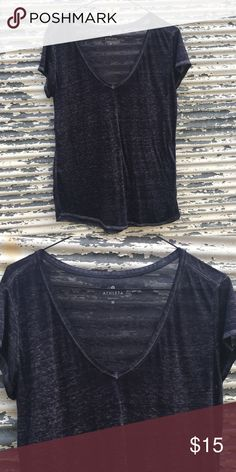 🆕 NWOT Athleta Soft Gray V Neck Tee Size Medium Unbelievably soft t shirt from Athleta. Unfortunately too big for me. NWOT.  Style Name: Athleta Easy V Sugar Wash Tee Size: Medium Retail Price: $59 Style # 983042 Fabric: 51% Polyester / 49% Cotton Athleta Tops Tees - Short Sleeve