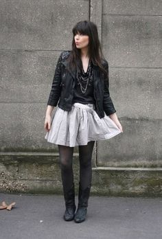 Favorite blog outfit of all time - Le Blog De Betty. Leather Jacket. Silver skirt. Black rider boots.