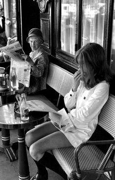 Henri Cartier-Bresson photographs a girl at a Parisian cafe (1969)