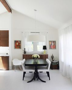 DINING ROOM • credenza: HD Buttercup • dining table: Rose Bowl flea market find • dining chairs: IKEA • pendant fixture: CB2