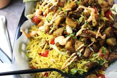 Halal Cart Chicken is boldy spiced and served with fragrant Turmeric Rice and spicy yogurt sauce. The perfect copycat of NY cart food.