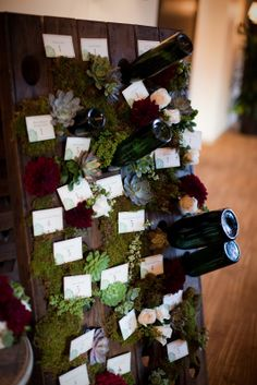 Wine Wedding Idea - Riddling rack as an escort card table. The holes were filled with an assortment of wine bottles, sheet moss, dahlia blooms, ivory roses, and succulents. Mod Wedding, Floral Wedding, Wedding Flowers, Summer Wedding, Rustic Wedding, Theme Nature, Wine Display, Ivory Roses, Wedding Favors Cheap