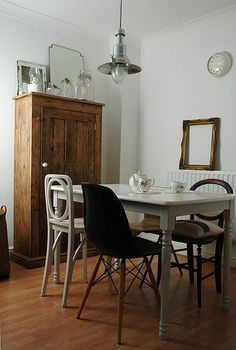 GREAT mix and match chairs & super cabinet with display...whites, natural woods, black and metals...