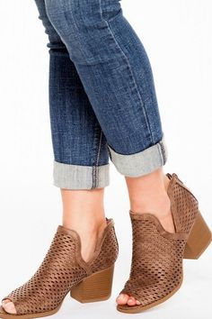 Step in style wearing the Make Way Taupe Cutout Peep-Toe Ankle Booties! Distressed vegan leather shapes a laser-cut upper with dipping sides and an open peep-toe. The covered heel has a camouflaged zipper and a block heel finishes the look.