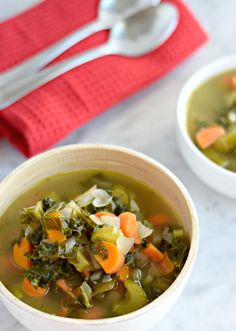 This Winter Kale Vegetable soup is loaded with vegetables like kale, carrots and celery and packed with super savory herbs like rosemary, thyme and garlic. Perfect for the cold winter days. (gluten free, paleo, vegetarian, vegan) - fromcatstocooking.com