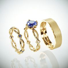These rings is my interpretation for the infinity symbol.  Two lines representing a man and a women blending  together in a perfect harmony to infinity. The delicate gold wires interwoven with each  other to symbolize the bond of the marriage. I've  created the Sapphire bezel to continue the flow of the  ring, uniquely enabling to view the Sapphire in all its glory.  #WeddingandEngagement #bridaldiamondring #weddingringsset #HisAndHersRings #SapphireBridalRing #SapphireBridalBand #HisHerss