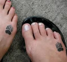 so cute- small bear paw print tattoo on foot not sure if I like the placement that much