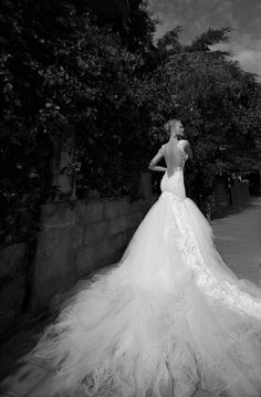 Beautiful Wedding dress with dropped opened back and long dramatic train via Etsy
