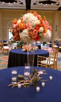 Tall, full, white, peach and green centerpiece.