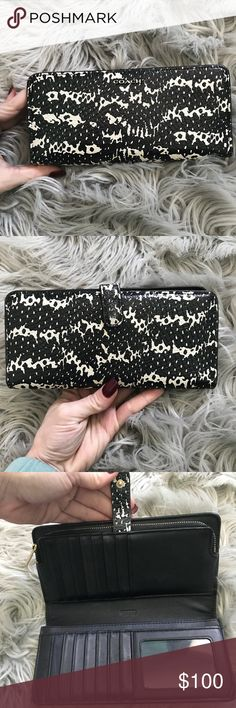 "Authentic COACH wallet Beautiful ""Phoebe"" python leather wallet used lightly. Black and white snakeskin appearance quality leather. 100% authentic. 16 cars slots and tons of storage. Bought new from coach store a few years ago. It's been hanging out in my closet for awhile. She's beautiful 😍 slight wear on strap, shown in picture. Still have original receipt. Coach Bags Wallets"