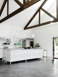 Beams and Stained Concrete Floors #Kitchen #Concrete #InteriorDesign #Industrial