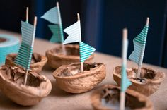 walnut boats... These look like they could easily amuse a little child.  Or choke them.  Either or.