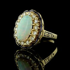 This gorgeous 14K yellow gold opal and diamond ring won't last in our store for long!