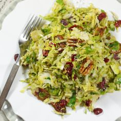 Sweet & Crunchy Brussels Sprouts 1 pound Brussles sprouts, shredded 1 tablespoon coconut oil or butter 1/2 teaspoon ground cinnamon 1/4 teaspoon sea salt 2 tablespoons fresh orange juice 1/2 cup dried cranberries 1/2 cup raw pecans