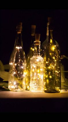 **wine bottle NOT included** Make your own DIY wedding lanterns with any standard size wine or liquor bottle. Classy wedding centerpiece! Perfect for a wine theme wedding. Creates lovely mood lighting at your rehearsal dinner, wedding reception or any dinner party! A great wedding