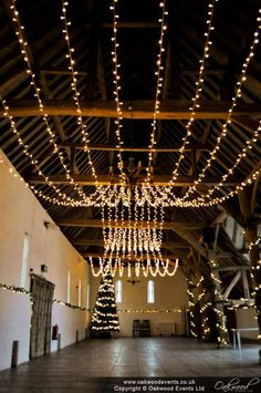 Our huge double gather fairy light canopy for added winter #wedding sparkle at Ufton Court! #barnwedding #lighting