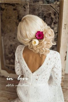 side loose wedding updo with flowers