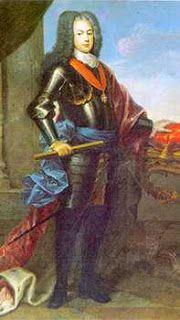 A DINASTIA DE BRAÇANÇA - 1640-1910 O ouro brasileiro  ajudou a financiar a Revolução Industrial Inglesa e a criar, a hoje famosa Bolsa de Londres.  O seu reinado, que durou de 1706 até à sua morte em 1750, foi um dos mais longos da História portuguesa. Recebendo o nome de João Francisco António José Bento Bernardo, nasceu em Lisboa a 22  Outº 1689, filho de D. Pedro II e de D. Maria Sofia de Neuburgo, e foi aclamado rei a 1  Janeiro 1707. Casou D. Maria Ana da Áustria,filha do Imp. Leopoldo…
