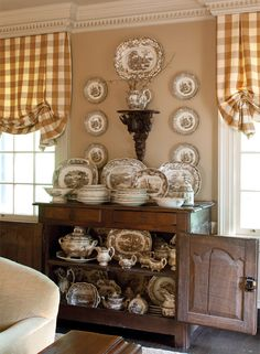 Room with brown and white 19th century pottery and gingham/checked shades -- photo: John O'Hagan -- The Cottage Journal
