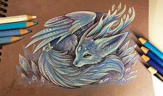 Crystal fox spirit by AlviaAlcedo on DeviantArt Rare and pretty magical creature. Gives a good luck for everyone, who will see it. It looks so small and cute^^' Looks like, it's afraid of people. Pencils, pens on a brown textured paper Art & Fantasy Drawings, Cool Drawings, Fantasy Art, Cute Wolf Drawings, Amazing Drawings, Realistic Drawings, Beautiful Drawings, Beautiful Artwork, Creature Drawings