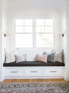 AMBER INTERIORS // Window seat, throw pillows, decorative pillows, sconces, vintage rug