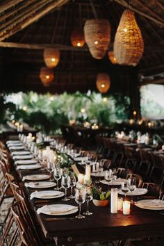 The dinner was held inside of a thatched-roof palapa. Long tables were placed close together, and both dinner and wine were served family style, to give that intimate dinner-party feel. We worked with our florist to create rustic centerpieces that looked more gathered than arranged—featuring wooden bowls filled with tropical greens, aloe vera, and local fruits and flowers.