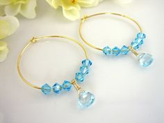 Sky blue topaz Swarovski crystal gold hoop earrings by KBlossoms, $32.00