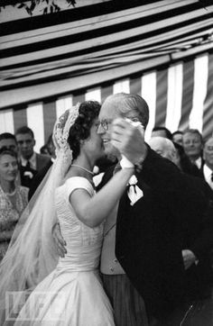 At her 1953 wedding reception, Jackie Kennedy dances with her new father-in-law, Joseph P. Kennedy. Jackie and JFK's father would become close over the years. Her own father, Jack Bouvier, missed her wedding ceremony completely after getting drunk in his hotel room (stepfather Hugh Auchincloss walked Jackie down the aisle).