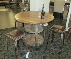 Made from recycled wine barrels, this set truly is unique and re-purposed! Finished in a Carmel stain and upholstered in chocolate leather this set is a perfect accent table for a wine cellar, kitchen nook, or basement game room.