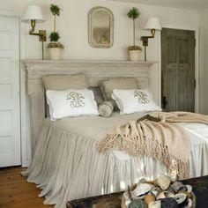 Photo only: beautiful bedspread, fireplace mantle as headboard.